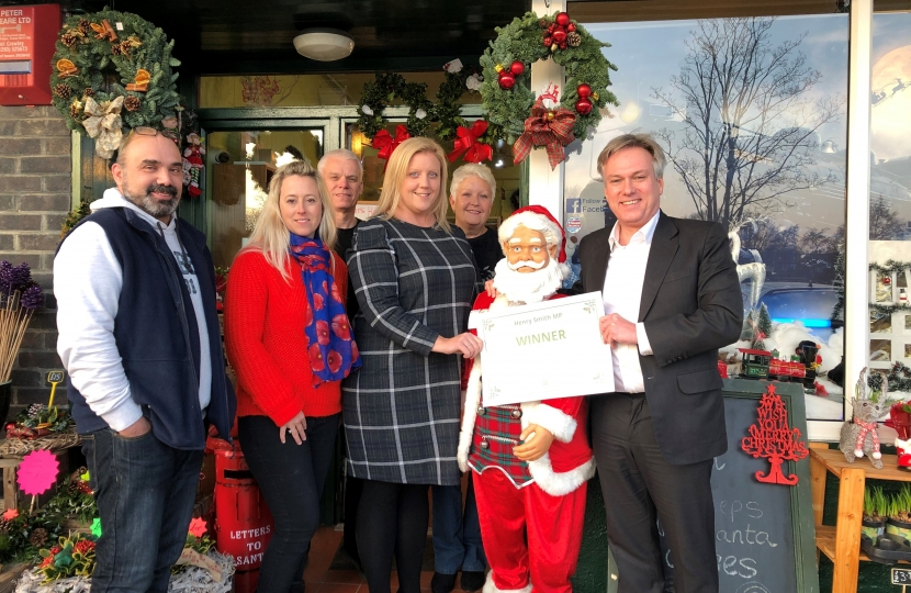 Henry Smith MP congratulates Festive Crawley Christmas Shop Window Winner