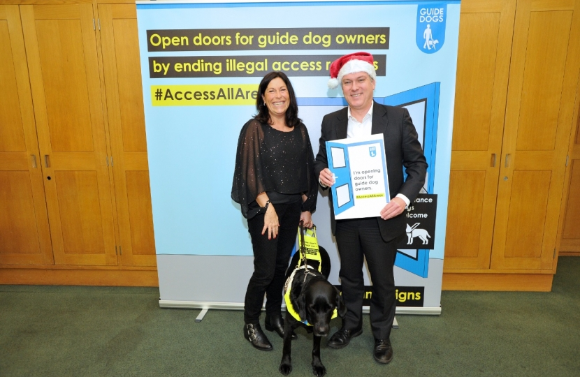 Henry Smith MP helps Open Doors for Guide Dog Owners this Christmas
