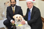 MP gets a visit from Guide Dog's Santa Paws this Christmas